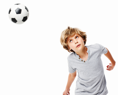 Boy Heading a Soccer Ball - Isolated